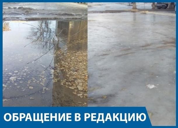Второй месяц из-под асфальта во дворе волгоградской многоэтажки бушует «фонтан коммунальщиков»