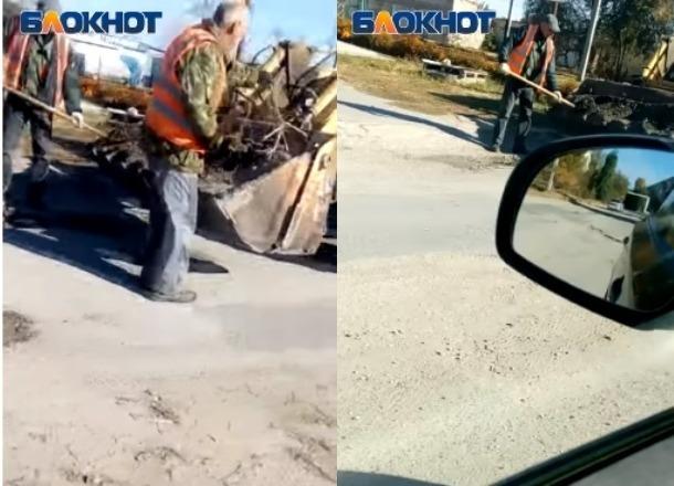 Ноу-хау по-городищенски: ямы в дорогах коммунальщики заделывают миксом земли и веток