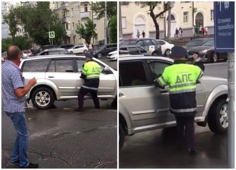 Полицейский набросился с кулаками на машину нарушителя в центре Волгограда